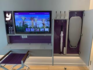 Mini work area, hooks, umbrella, and ironing board