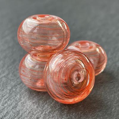Handmade hollow lampwork glass beads made with CiM Solar Storm