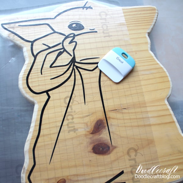 Place the vinyl on the wood cut out for the perfect Baby Yoda party decoration