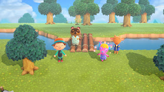 me and my starting villagers, Fuchsia and Billy, at a bridge ceremony with Tom Nook