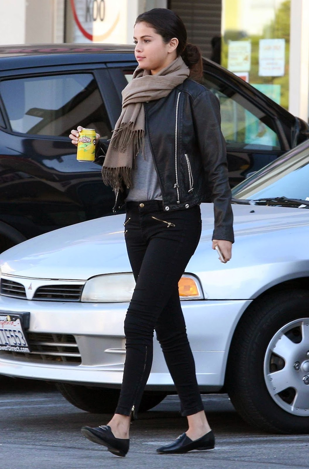 Selena Gomez in skinny jeans and leather jacket out and about in Studio City