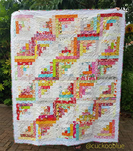 Scrappy Log Cabin Quilt designed by Papiya Russell of Cuckooblue