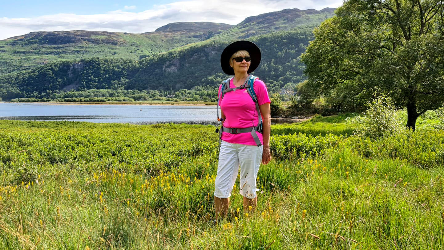 Over 50s blogger Gail Hanlon walking in the meadows alongside Derwentwater in the Lake District