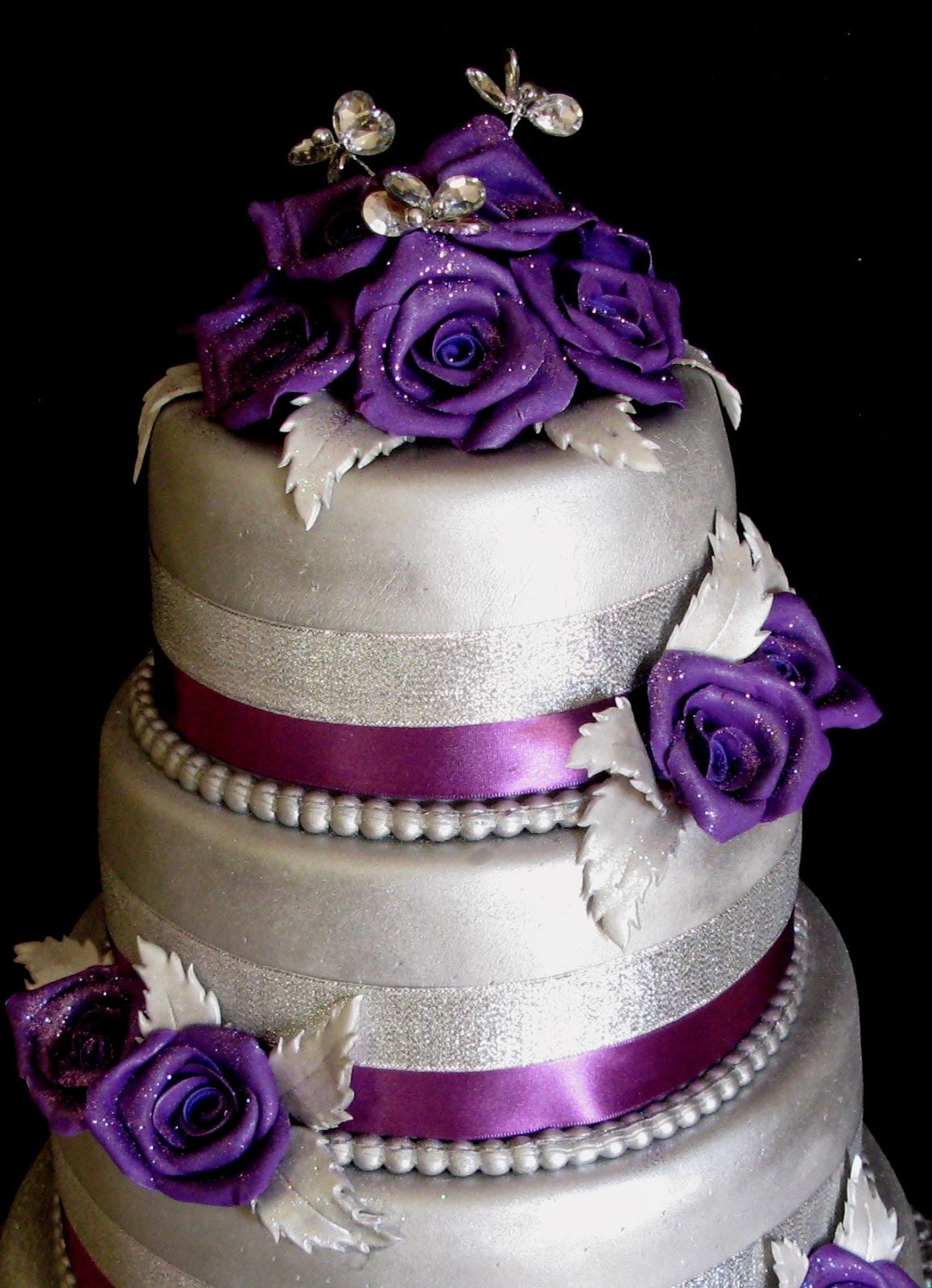 four layer wedding cake purple roses purple and silver wedding Four Layer Wedding Cake Purple Roses and Silver Hue