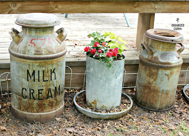 Decorating the Yard & Garden with Vintage Milk Cans #vintage #farmtools #milkcan #creamcan #junkgarden #outdoordecorating #stencils