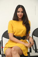 Actress Poojitha Stills in Yellow Short Dress at Darshakudu Movie Teaser Launch .COM 0194.JPG