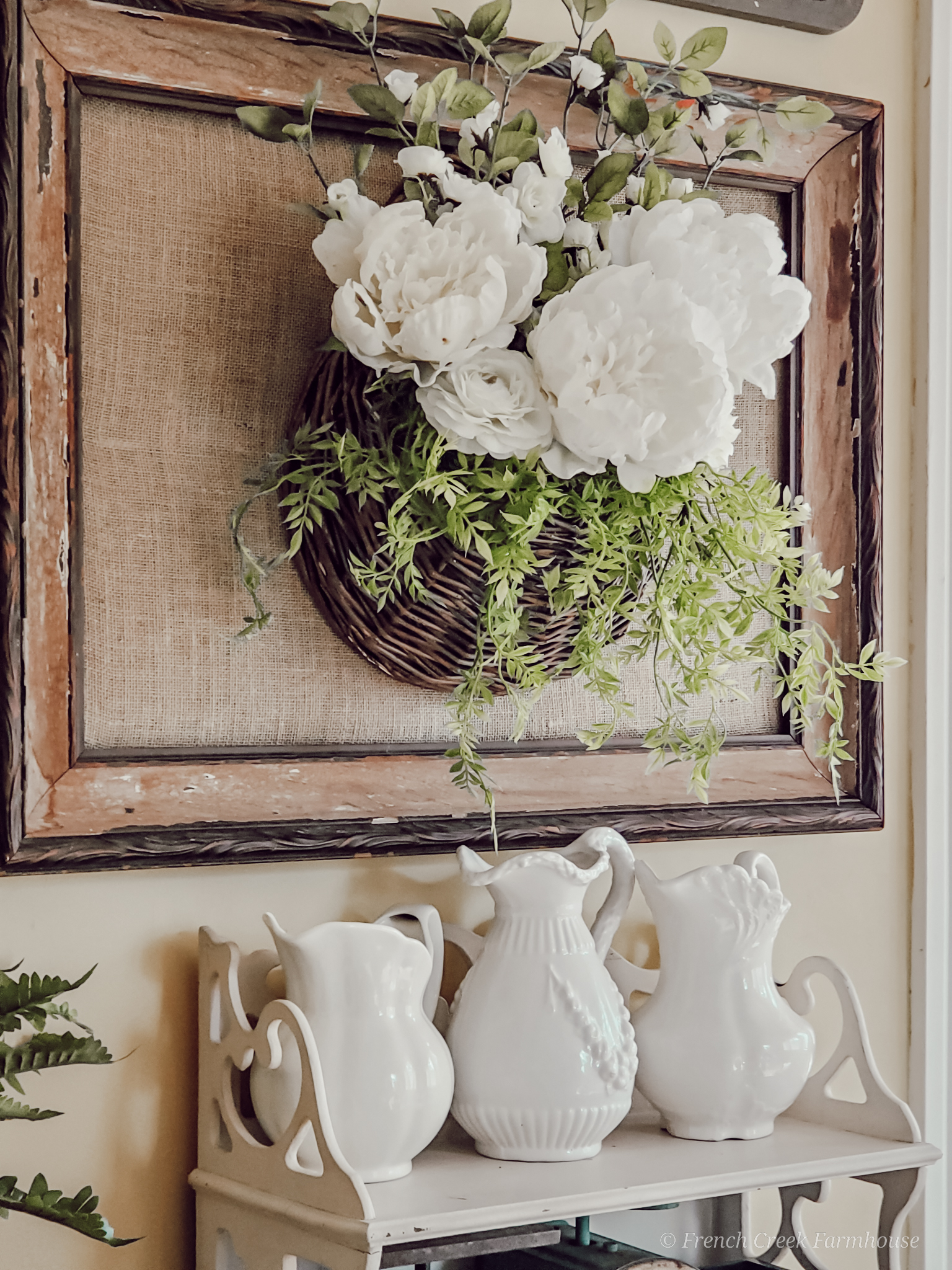 Wall hanging basket filled with white peonies