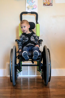 portrait of Westyn in his wheelchair