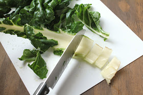 chopping stem of swiss chard with knife
