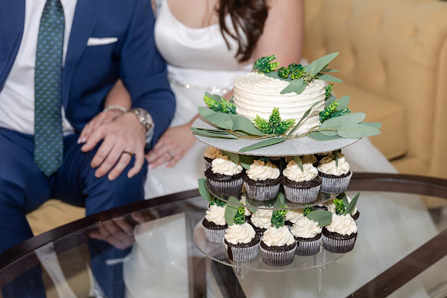 bride and groom portrait with cupcakes