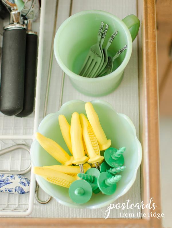 vintage jadeite in kitchen drawer with corn cob holders