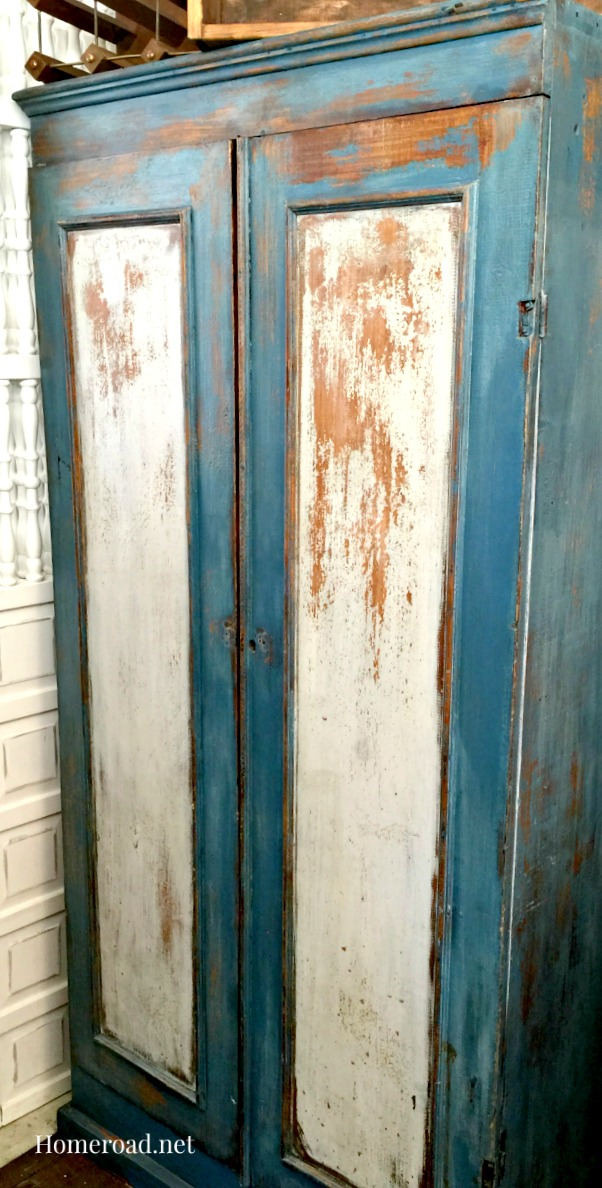 Blue and white chippy milk painted cabinet
