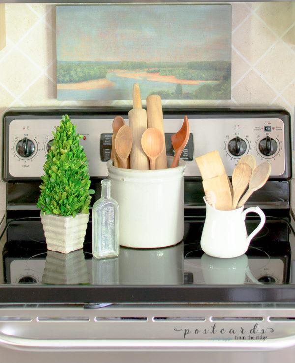 old stoneware crock repurposed as kitchen utensil holder