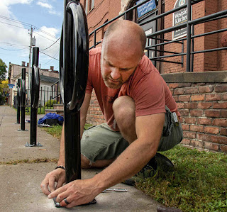 Matt VanSlyke installs bike racks