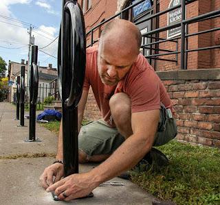 Matt VanSlyke installs bike racks