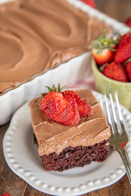 chocolate cake on a plate with strawberries