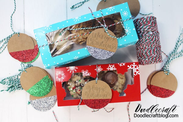 I love aqua blue. It should be part of every holiday color scheme!   I made a bunch of fun cookies...but I only used 2 recipes. I make my favorite chocolate chip recipe and then split the dough into 3 or 4 or 5 sections and make each of them a little different. Check out this post here for the recipe!  And I made these Special K Treats that are divine! Check out this post for the recipe!  I layered parchment paper in the boxes so the cookies don't stick together or mix. I think they look so cute peeking out of the window boxes.  The blue box holds 6 cookies, the red snowflake box holds 4.