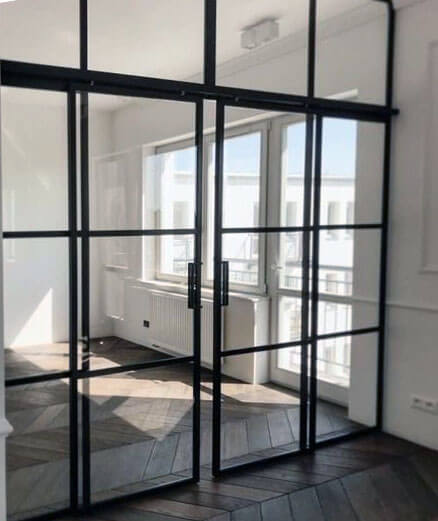 How can a glass loft door be framed?