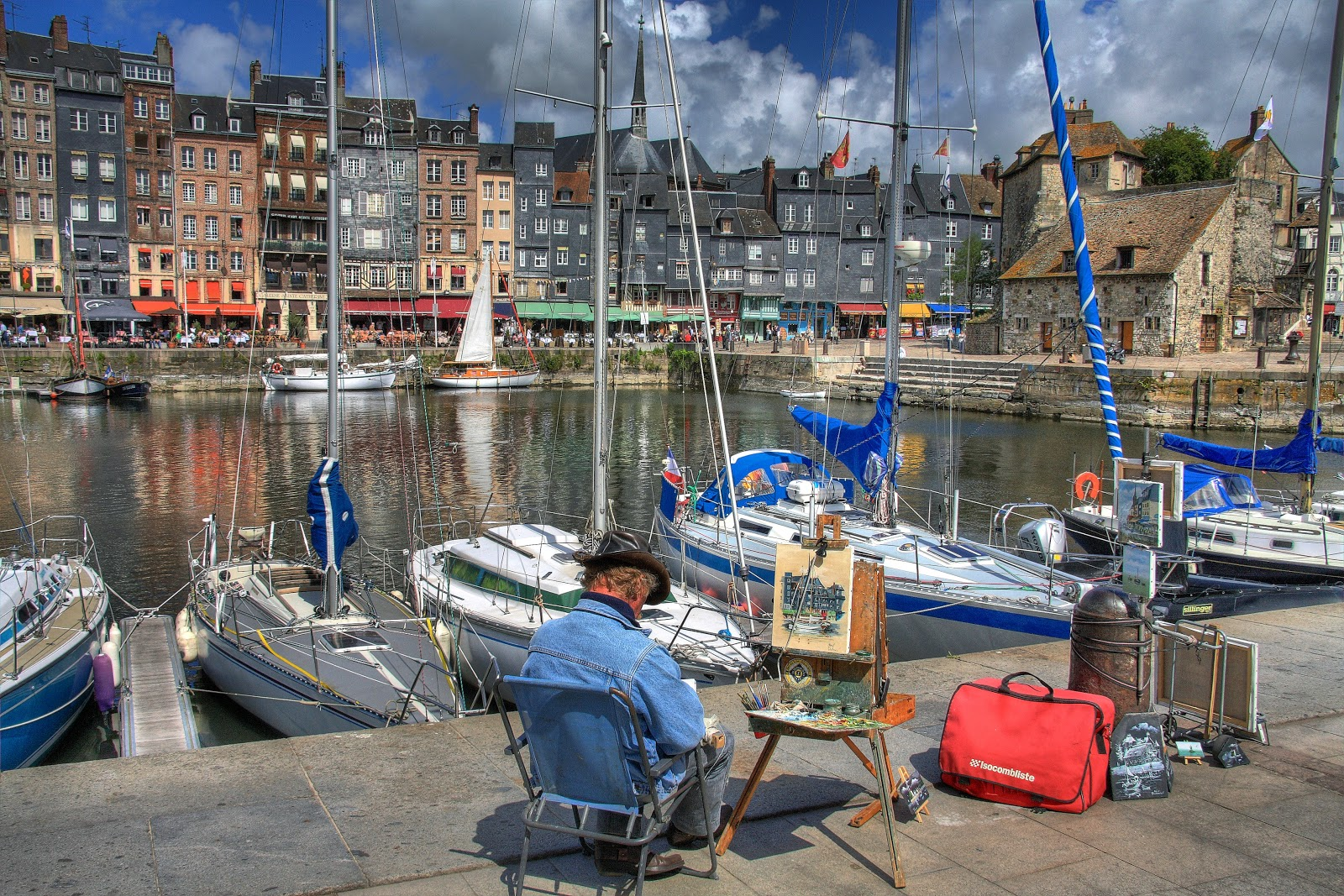 After spending the morning on the Thatched Cottages tour or the Normandy Abbey's, opt for the excursion to a picturesque village of Honfleur along the coast.