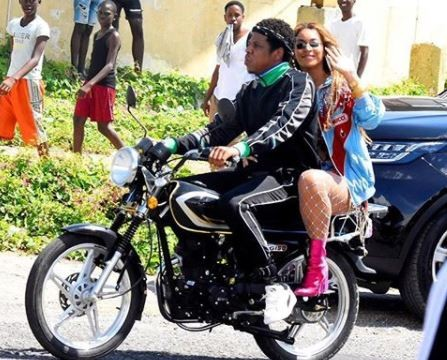 Power couple Jay-Z and Beyonce cause a stir as they go for a bike ride in Jamaica (Photos/Video)