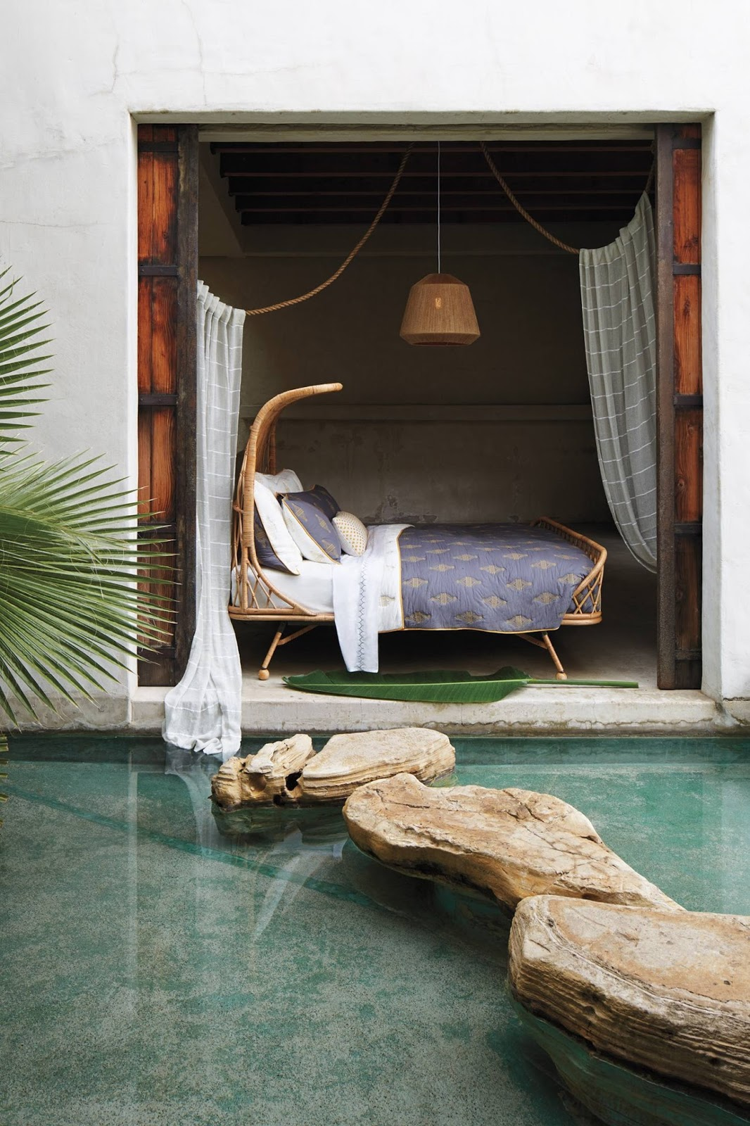 YAAAS!! Anthropologie Curved Rattan Bed Takes My Boho Breath Away
