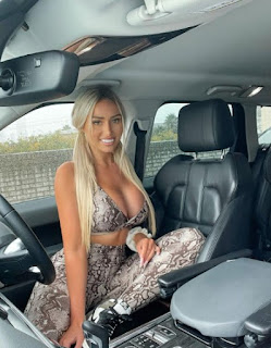 Georgina Gentle posing for picture while sitting inside the car