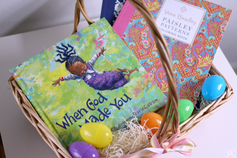 an Easter basket with a book and coloring books in it