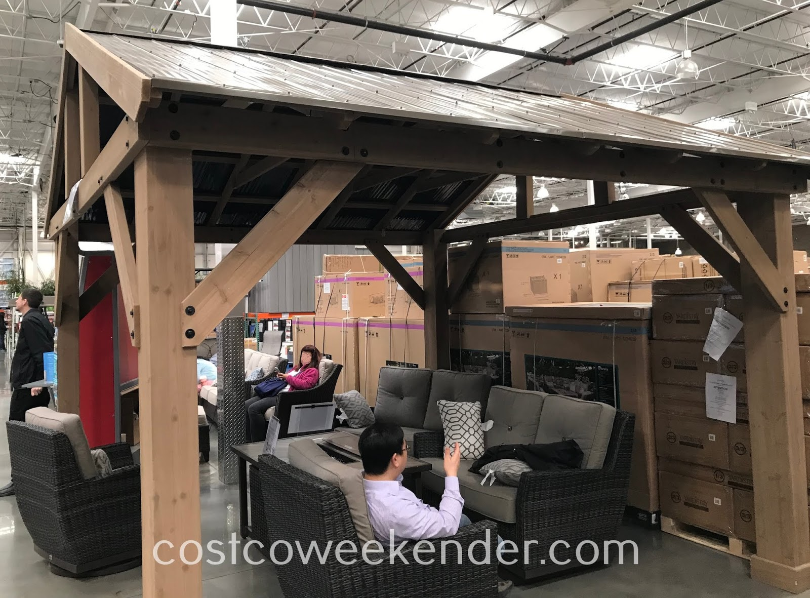 Enjoy being outside in your backyard while getting some shade under the Yardistry Cedar Wood Pavilion