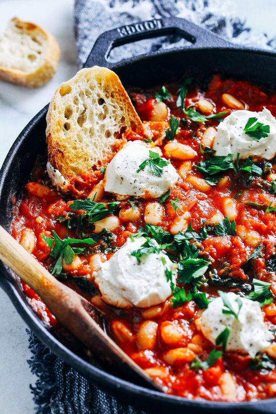 One-Pot Vegan White Bean Shakshuka- perfect for an easy weeknight meal, this vegan shakshuka only takes 30 minutes to make and is bursting with nutrients and flavor!