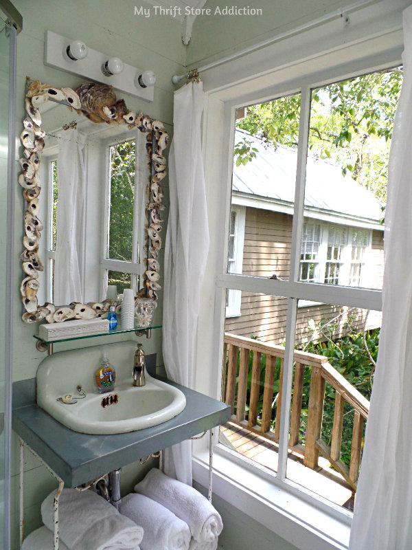 A Secluded Stay at the Bide-A-While Retreat mythriftstoreaddiction.blogspot.com A spa worthy shower and stunning shell mirror in The Cottage