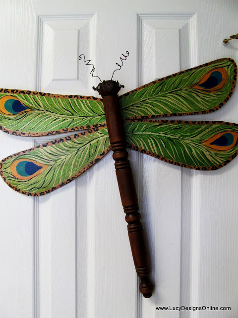 lucy designs dragonfly with peacock design