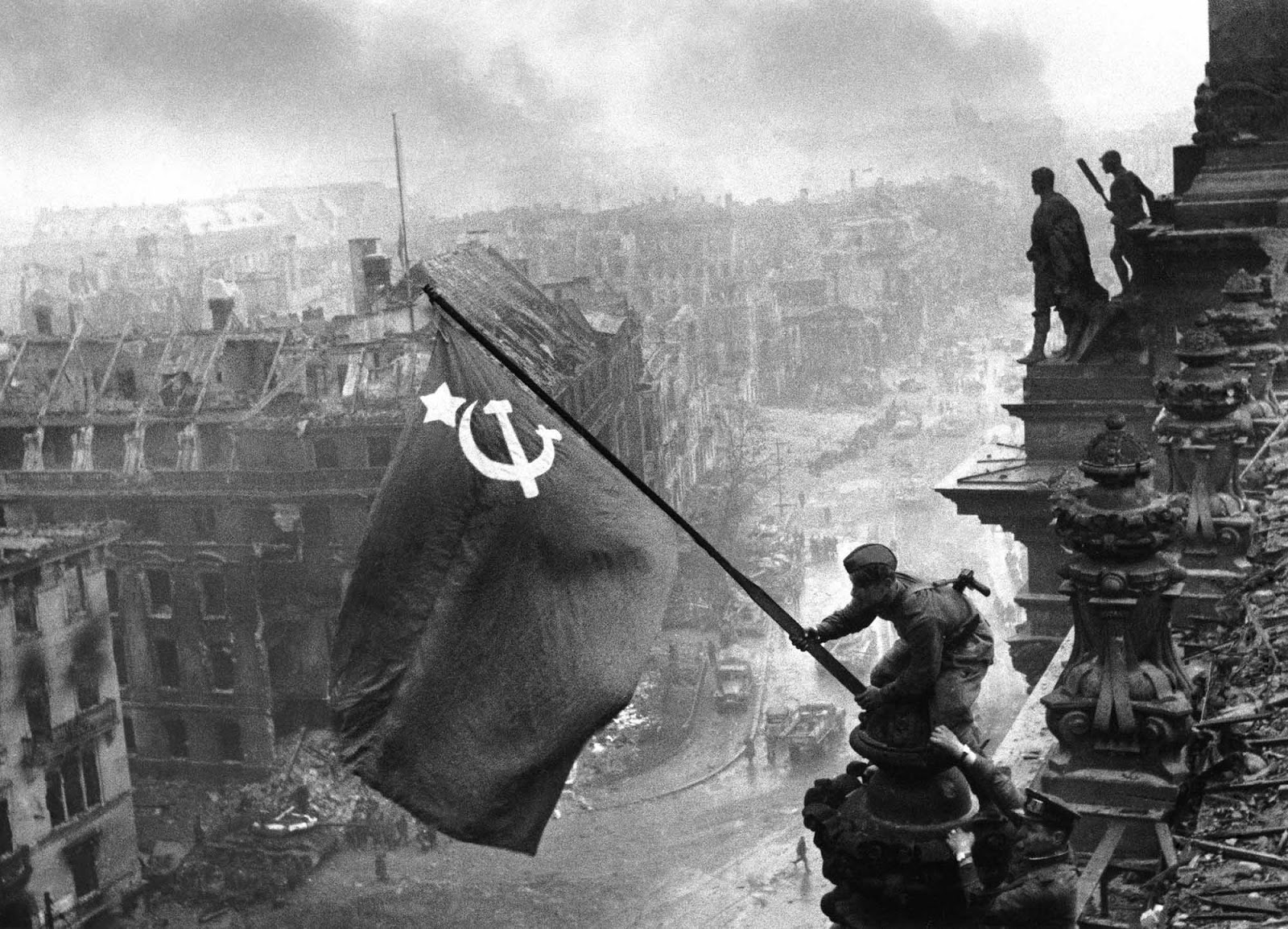 Soldiers raising the Soviet flag over the Reichstag, 1945.