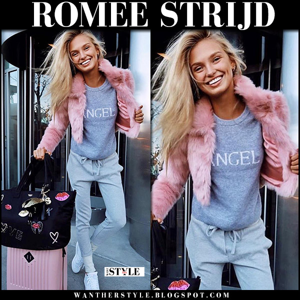 Romee Strijd in pink fur jacket lovers friends, grey sweater victorias secret and grey sweatpants with pink suitcase street style model november 16 2017