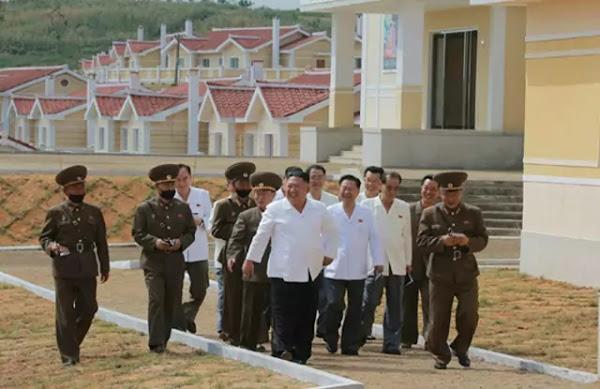Kim Jong Un at rebuilt Kangbuk-ri