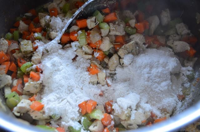 Cooked Chicken and Vegetable mixture sprinkled with flour for Homemade Chicken Pot Pie.