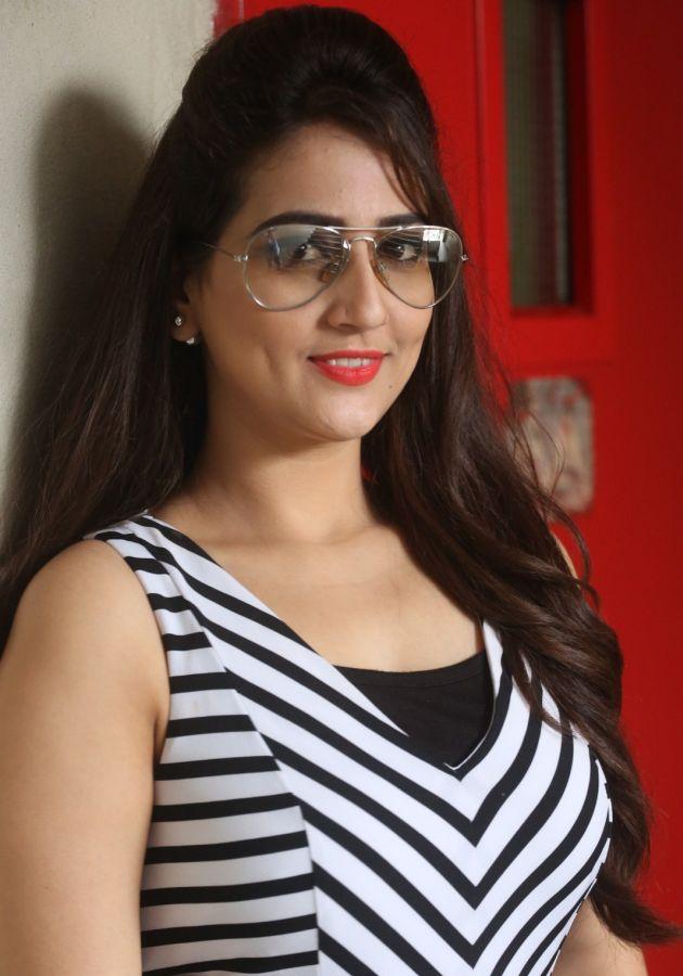 Glamorous Anchor Manjusha Photoshoot In Black Dress With Glass