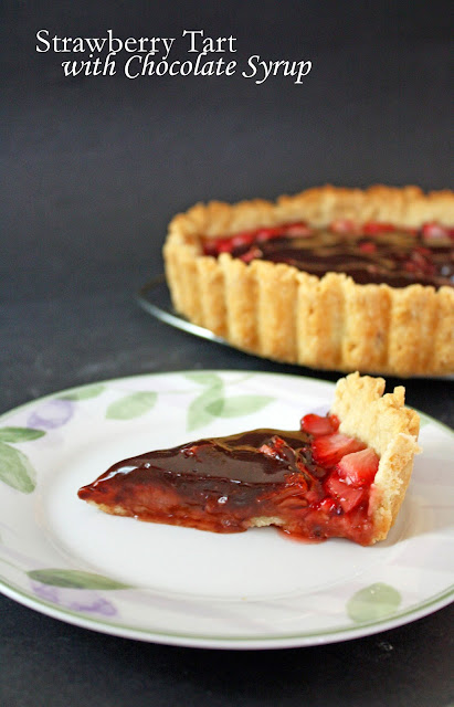 strawberry tart with chocolate syrup