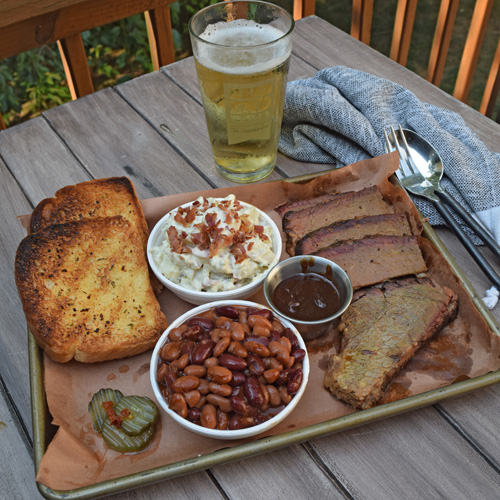 Sliced brisket platter with Bush's Mixed Chili Beans, jalapeno garlic potato salad and texas toast