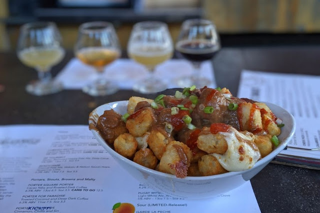 What to Eat in Boston: Spicy Poutine tater tots and craft beer at Slumbrew