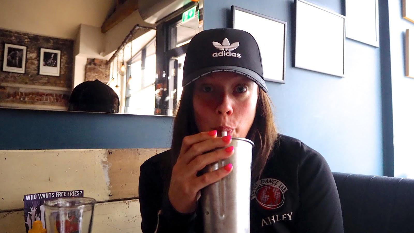 Drinking a milkshake