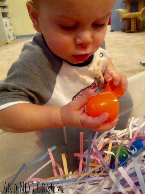 K checking out the easter sensory bin from And Next Comes L