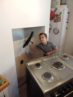 bare plasterwork for painting boy with chimney sweeps brush