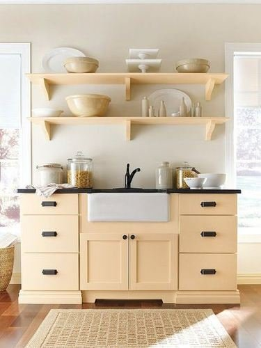 These clean and simple wooden kitchen shelves match the cabinets and give a very cohesive look to this kitchen