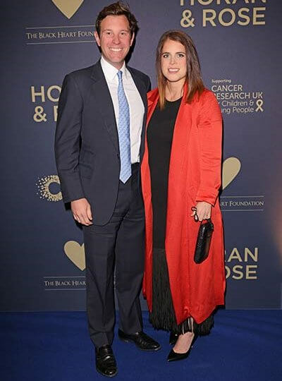 Princess Eugenie wore a black fringe-trimmed maxi dress by Sandro, and a red duster coat by Galvan,