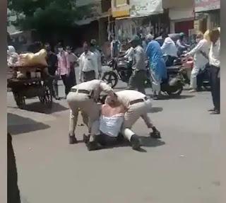 इंदौर में मास्क नहीं पहनने पर दो पुलिसकर्मियों ने एक युवक को जमकर पीटा, वीडियो वायरल