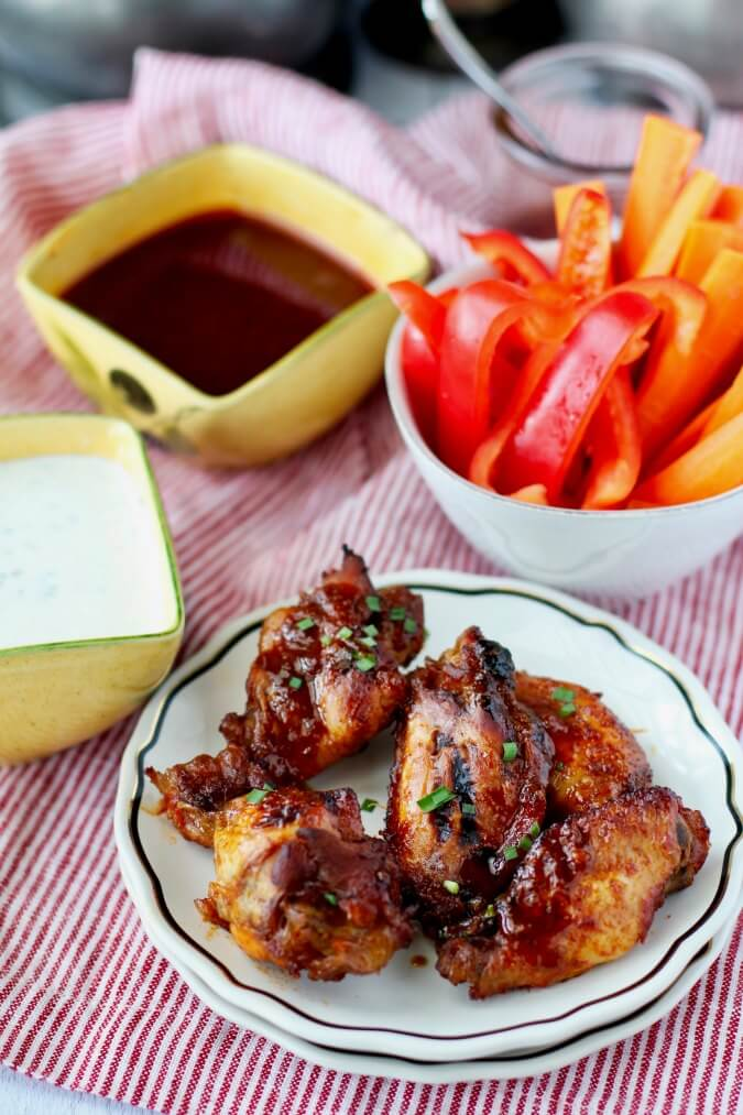 Hot Honey Chicken Wings with sauces and veggies