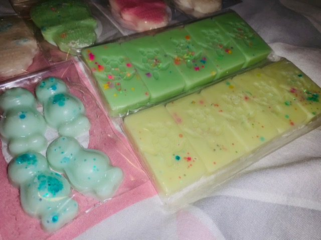Wax melts in the shape of jelly babies and rectangle slabs