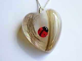 Lock of hair and ladybird pendant