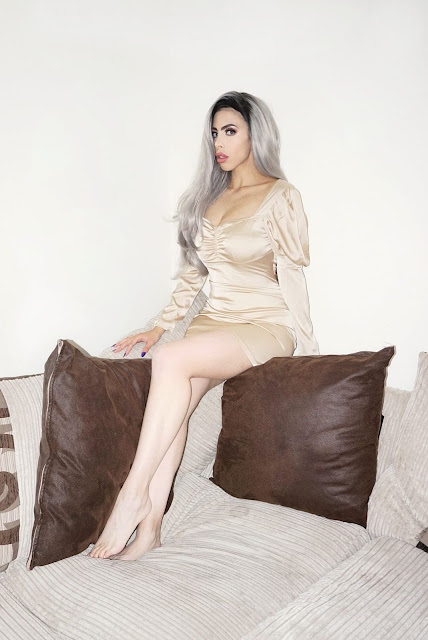 Fashion blogger Savana Rae wearing the Femme Luxe Camel Satin Puff Sleeve Bodycon Mini Dress in model Winona