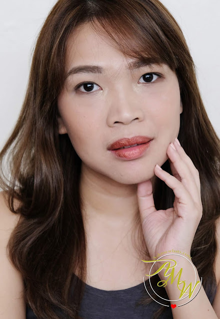 a photo of Nikki Tiu Askmewhats wearing Sleek MakeUP Metallic Matte Lip Cream in Copperplate